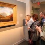 Visitors admire a painting by Lauren Sansaricq, a contemporary North Conway artist. From the Mus