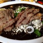 Enmoladas... tortillas covered in black mole and a choice of meat (I chose carne aside)