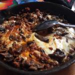 Quesillo Fundido... skillet dish that incorporates Oaxaca cheese, grilled chorizo and mushrooms.