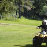 11 year old on a 150cc semi auto geared quad bike