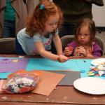 Kids work on art projects at an ArtStart Arty Party Opening