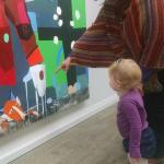 Visitors enjoy the art of T.L. Solien at ArtStart