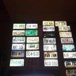 License plates on one wall.