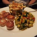 Seared scallops with lobster Mac n cheese and zucchini corn raquot!