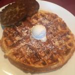 Delicious Belgian waffle with sausage patties
