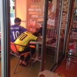Random Thai employees (?) sleeping outside the restaurant. 5 staff, all doing nothing