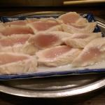 Second order of chicken sashimi served with a lemon zest.