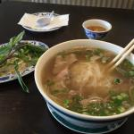 Rare Steak Pho. It comes with fresh mint, jalapeños, bean sprouts and lemon.