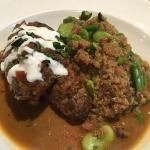 Juicy braised lamb with sweet yogurt sauce. Side is fava bean split, chopped asparagus and quino