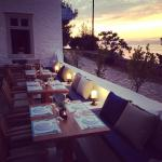 Ready for dinner service as sun is setting in Hydra