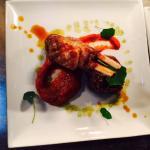 Ras el hanout spiced lamb shoulder with lamb cutlet, red pepper puree and nasturtium leaves.