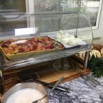 Continental breakfast with pastries, fruit, yogurt, eggs, coffee and juice