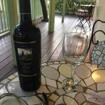Sitting on the front porch outside room with a bottle of vino from nearby Romeo Winery.