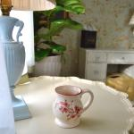 Enjoying a cup of coffee in the morning in the sitting area in The Cottage Room