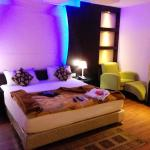 My room, with blue night lights surrounding the most welcoming bed ever
