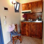 small kitcen with fridge in the room