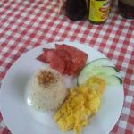 tasty and fresh. slice ham , garlic rice and scramble eggs