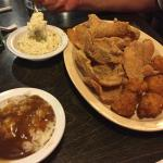 Thin fried catfish, rice and gravy and grits