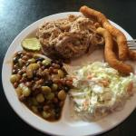 Pulled pork BBQ plate with cole slaw, baked beans and hush puppies.