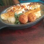 Broiled seafood platter and Tommy po boy sandwich