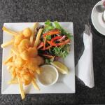 Yummy scallops with chips and salad