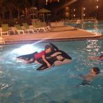 Grandchildren in pool (heated) at night, pool is gigantic!