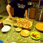 Brother Chris doing the honors. A very tasty pizza from Italian Garden Cafe!