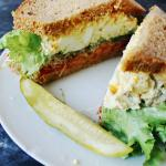 Egg salad w/ lettuce, tomato, honey mustard, sprouts. On homemade anadama bread.