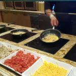 Best omlettes made to order...check out the 5 burners cooking all at once! Master Omlette maker!