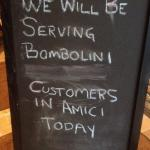 Sign indicating Bombolini Patrons would be eating in Amici