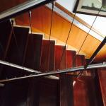Photos vu de l'extérieur de l'hôtel, escalier donnant accédé aux étages des chambres et chambres