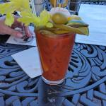 Awesome Bloddy Mary with boilked shrimp, pickled okra, green beans, etc. The mix is home made!