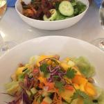 Beef salad at top was spicy and good, mango-cucumber salad at bottom was crisp and flavorful..