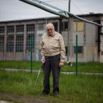 Erwin Farkas in front of one of the buildings he was a slave laborer in during the Holocaust