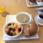 Continental five, cream cheese bagel, oatmeal, fresh fruit, coffee and (store bought) orange jui