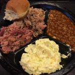 Combo plate with pork and ham... sides of bbq beans and potato salad...