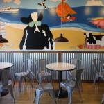 'Cow at the beach' themed mural inside.
