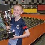 Birthday boy with the trophy