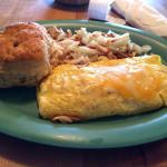 Simple but so delicious. Cheese omelette with hashbrowns and a biscuit.