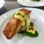 Pan seared Salmon served on dill and chat potato smash, lemon hollandaise and crispy capers - wi