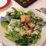 Dinner with a friend.  Brie Almondine & crostini, Caesar & Greek salads, Ribeye and lamb chops.