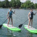 Friends having fun on the paddle boards