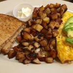 Build Your Own Omelette (tomatoes, spinach, cheddar cheese, avocado, ham) with potatoes, wheat t