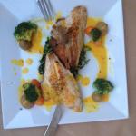 Sea bream on chorta and saffron sauce