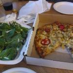 Spinach salad and gluten-free pizza