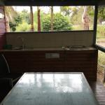 Balcony area with BBQ in deluxe 2 bedroom cabin