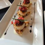Sea scallops on a garlic chive waffle with fig bacon jam and strawberry salsa