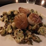 Awesome scallops over cauliflower, dates and olives
