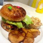 Cheese burger with mushroom and avocado toppings