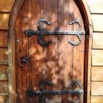 The wonderful wooden door to the church.